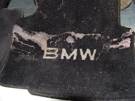 Stained BME 318i floor mat before cleaning
