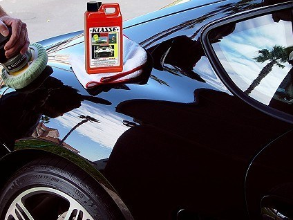 Applying and buffing Klasse All-In-One with dual-action car polisher.